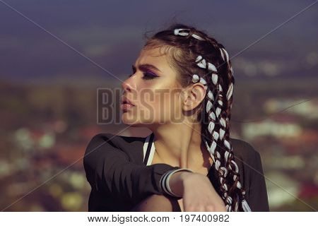 Hairdresser and barber. Girl with fashionable makeup. Beauty and fashion. Cosmetics and skincare. Woman has stylish hair with rope.