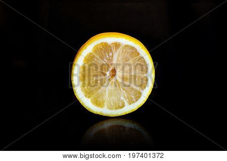 Cut A Ripe Lemon Isolated On Black Background