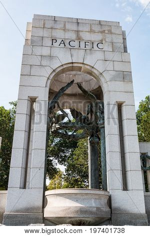 WASHINGTON, DC - JULY 12, 2017:  The Pacific triumphal arch of the World War II Memorial, dedicated to Americans who served in the armed forces or as civilians during World War II.