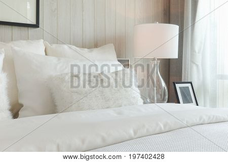 Luxury Style Bedding With Puffy Pillow And White Table Lamp In Bedroom