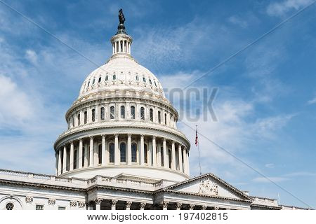 WASHINGTON, DC - JULY 12, 2017:  The United States Capitol Building, located on the eastern end of the National Mall, home of Congress and a symbol of government in America.