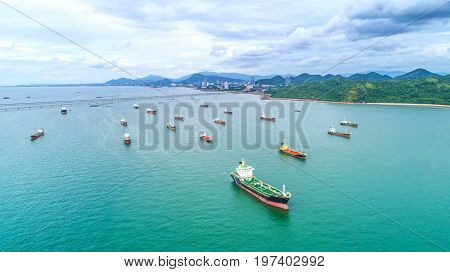 oil tanker gas tanker in the high sea.Refinery Industry cargo ship. top viewaerial viewThailand in import export LPGoil refinery Logistics and transportation with working crane bridge in harbor