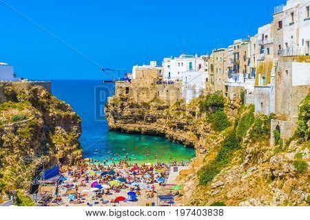 Small beach in amazing polignano mare city Bari region Puglia southern Italy.