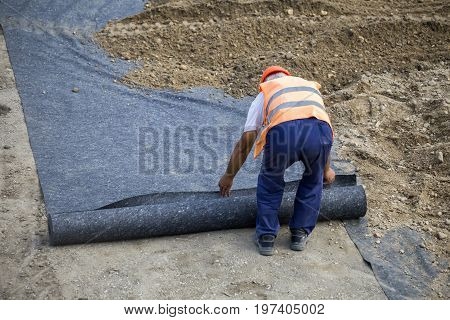 Worker Laying Geotextile