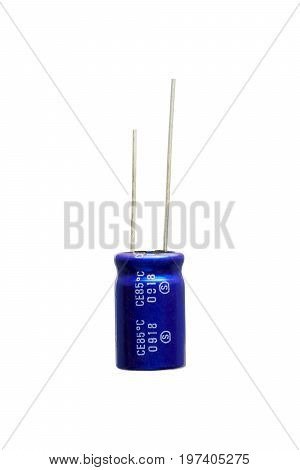 Blue electrolytic capacitor Isolated on white background Electronics part concept.