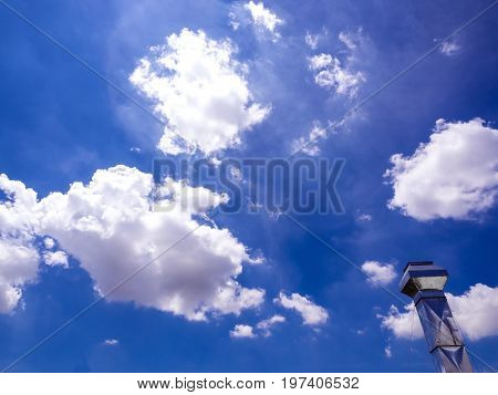 Shiny Steel Smokestack And Cloud In Sky