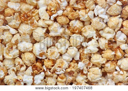 Crunchy fried appetizing popcorn. Food background. Corn.