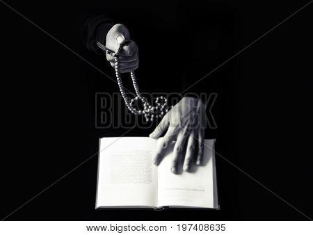 Young Praying Hands With Wooden Rosary And Holy Bible.