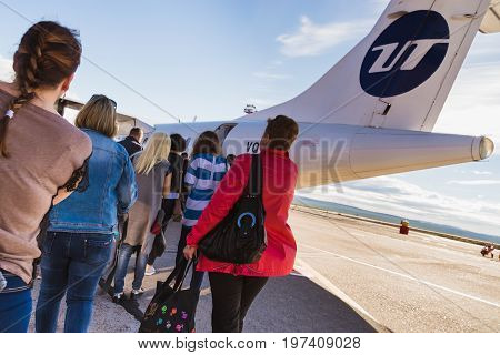 Norilsk, Russia - June 27, 2017 PASSENGERS RISE BY THE AIRCRAFT
