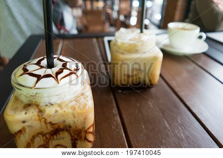 coffee iced coffee mocha on table wood background in cafe