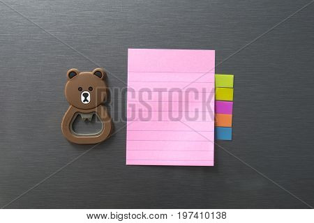 Empty Paper Sheet On Refrigerator Door. Note Paper With Magnetic Bear.