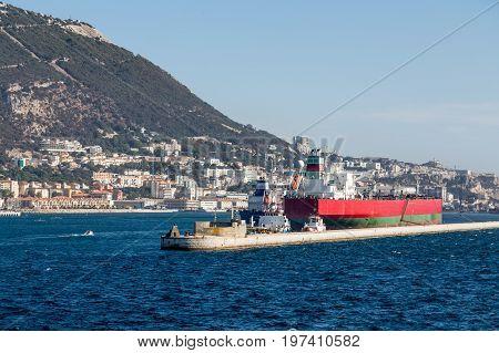 Tanker Ships at Seawall in Gibraltar harbor