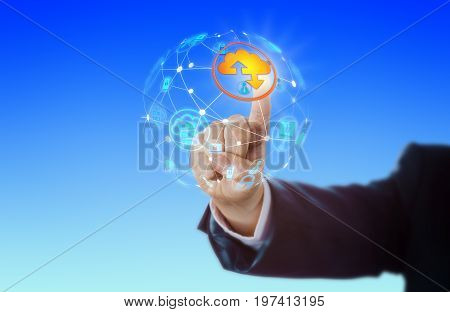 Hand of business man is activating a cloud computing icon in a globe shaped virtual computer network. IT concept for networking internet cloud storage wireless technology and global reach.