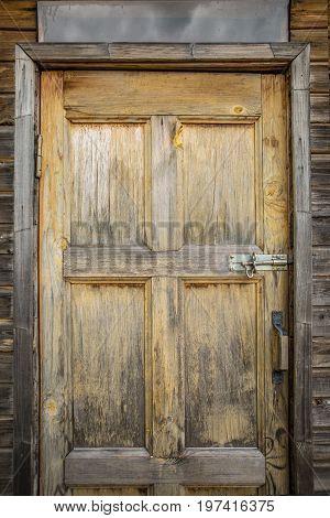 Photo of brown wooden door, rustic background