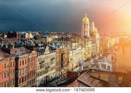 Panoramic view of St. Petersburg from roof top in sunset. Houses, streets and Cathedral of the Vladimir Icon of the Mother of God. Saint Petersburg downtown