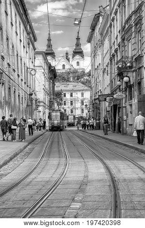 Lviv Ukraine - August 15 2016: Historic center of Lviv on the corner of Market Square. Vintage black and white