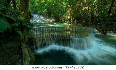 Waterfall in rainforest at National Park Kanchanaburi Thailand