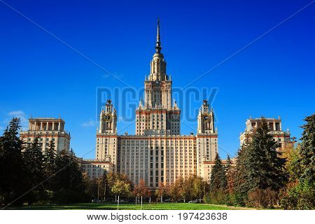 MOSCOW RUSSIA - OCTOBER 13 2015: Main building of Lomonosov Moscow State University or MSU against clear bright blue sky. Education in Moscow Russia