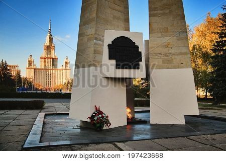 MOSCOW RUSSIA - OCTOBER 13 2015: Eternal flame and obelisk in memory of fallen students and teachers of Moscow state University in great Patriotic war in 1941-1945