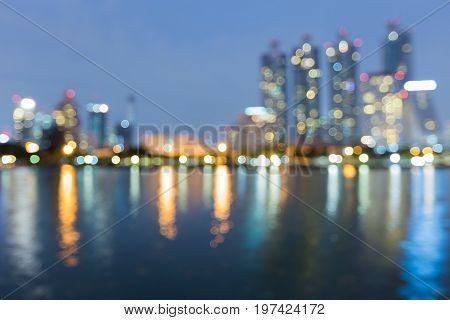Blue twilight night view Bangkok city office building with reflection abstract background