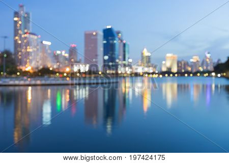 City blurred bokeh light with reflection abstract background