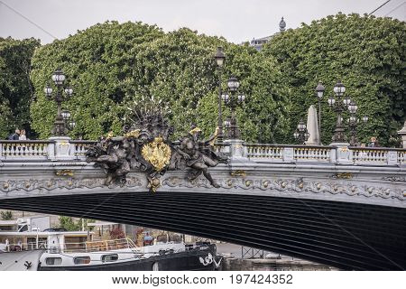 ParisFrance- April 29 2017: View of the Alexander lll Bridge. Nymph of the Neva with official symbols of Czarist Russia