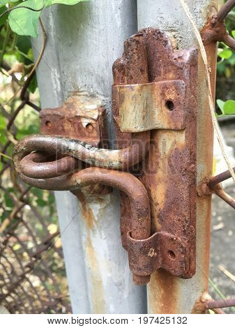 close up old dirty rusty latch in garden