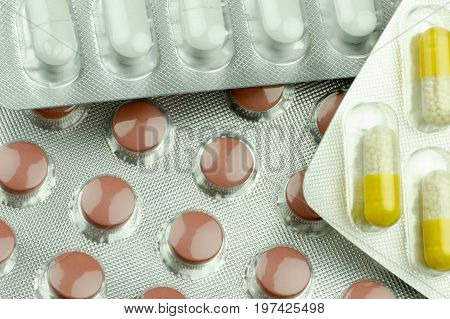 Close-up view of colorful pills of different drugs and vitamins