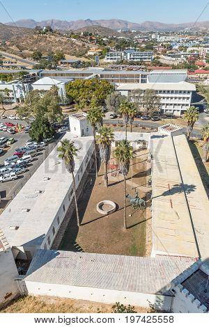 WINDHOEK NAMIBIA - JUNE 17 2017: Aerial view of the Alte Feste oldest building in Windhoek and Windhoek High School. The infamous Reiterdenkmal is visible in the inner court of Alte Feste