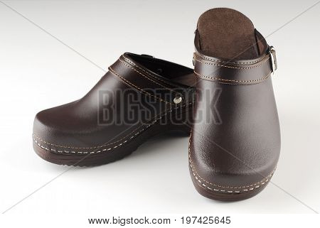 Beautiful pair of brown modern clogs isolated