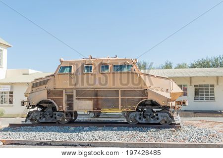 WINDHOEK NAMIBIA - JUNE 17 2017: An armoured vehicle on rails on display at the railway station in Windhoek