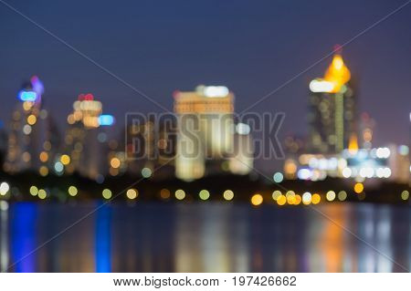City blurred bokeh light downtown with reflection abstract background
