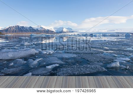 Opening wooden floor Jakulsarlon ice winter seasion lagoon with mountain and clear sky background Iceland natural landscape background