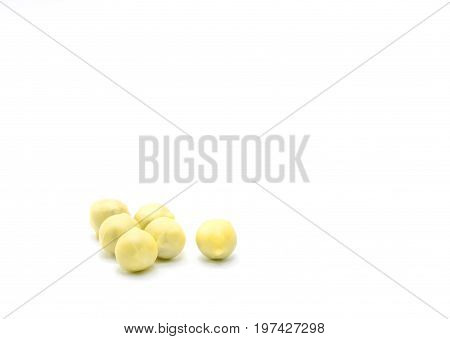 Chinese bolus herbal medicine is coated with yellow wax isolated on white background