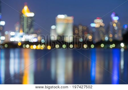 Twilight blurred bokeh city office building with reflection abstarct background
