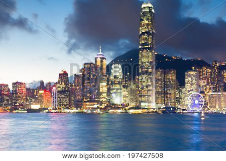 Twilight blurred boke light Hong Kong city downtown sea front abstract background