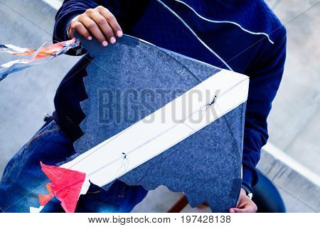 Boy holding a handmade paper kite on the popular festivals of makar sankranti and independence day in India