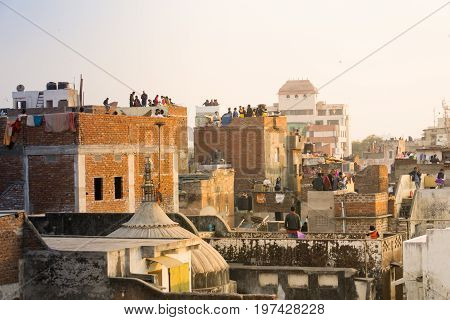 Jaipur, India - 14th Jan 2017 : Families flying kites from the rooftops of their old brick buildings in the old city of Jaipur. This is a popular sport of Makar Sankranti and Independence Day.