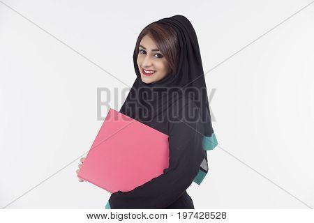 Arabic student wearing abaya holding a document