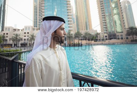 Arab young man looking to Dubai skyline