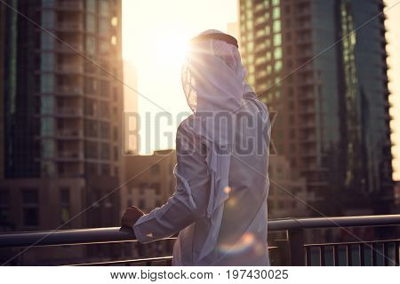 Arabic man looking to the sunrise sunset Dubai