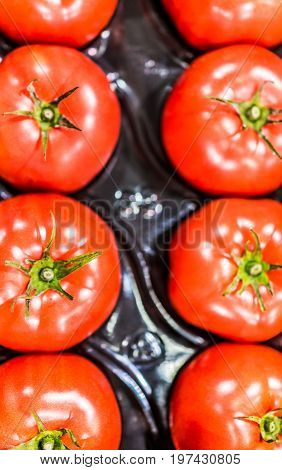 Macro Closeup Of Beefsteak Tomatoes In Packaging
