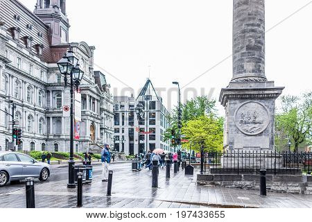 Montreal, Canada - May 26, 2017: Nelson's Column In Quebec Region With People Walking In Rainy Cloud
