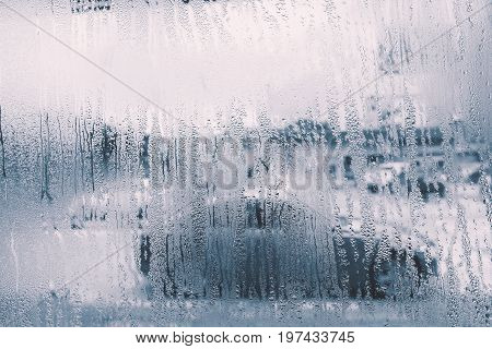 raindrops on glass window in rainy season with monotone