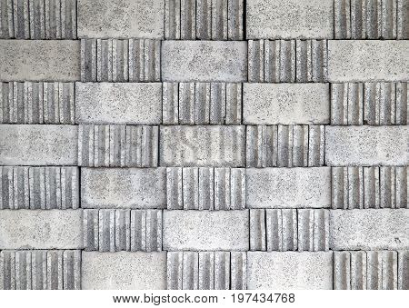 Pattern of stacked grey concrete blocks for construction background
