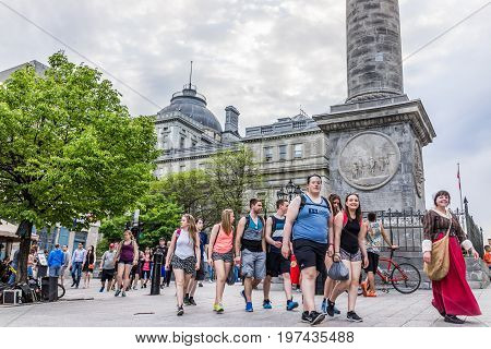 Montreal, Canada - May 26, 2017: Nelson's Column In Old Town Area In City In Quebec Region With Peop