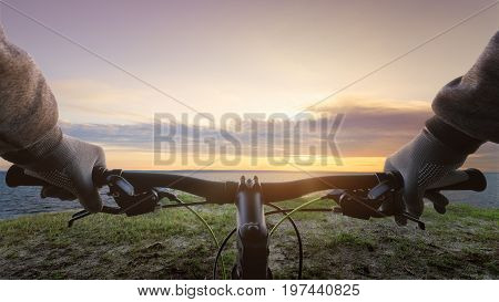 Bicyclist on a background of sunrise / bright dawn early spring