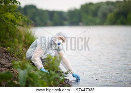 Environmentalist takes sample of water