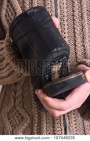 Photo of Man shoemaker repair broken shoes .