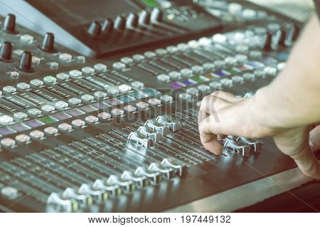 Fingers Move The Sliders On The Big Sound Mixer 4